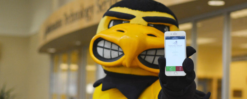 UI mascot Herky holds a mobile phone with Two-Step Login app displayed.