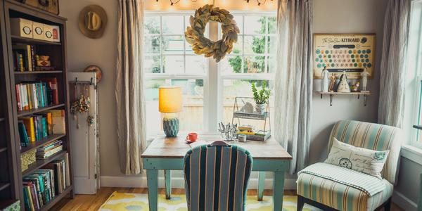 beige table with lamp and striped chairs in home office