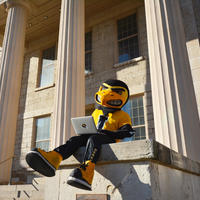 Herky with Wi-Fi on campus