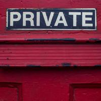 "Close up of door with mail slot and sign reading ""PRIVATE"""